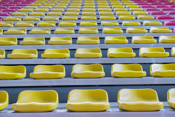 Rows of colorful empty seat in football stadium