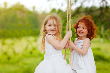 Two girls have fun and play in the Park in the summer.