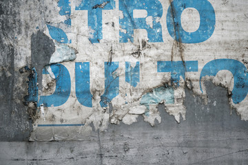 Torn poster after vote on tin textured wall. Ripped newspaper