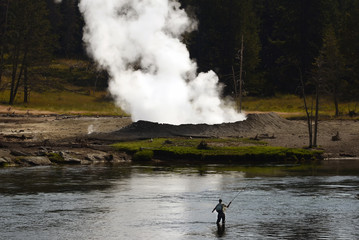 Fly fisherman fishing on the Yellowstone   River in Yellowstone National Park