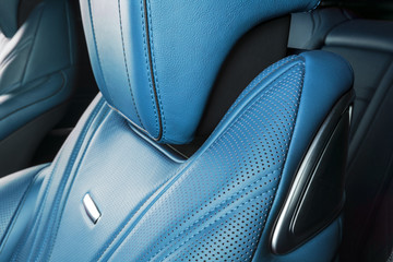 Modern Luxury car inside. Interior of prestige modern car. Comfortable leather red seats. Blue perforated leather. Modern car interior details