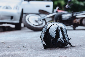 Black biker helmet on street