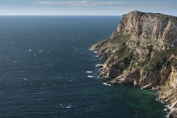 Cap d'Or tower and cliffs, Moraira,Costa Blanca, Alicante province, Spain, Europe