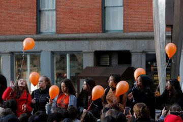 Students from the Millennium High School release balloons to honor the victims of the Marjory Stoneman Douglas High School shooting during a walkout of their classes while participating in the National School Walkout in Manhattan, New York