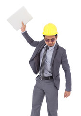 very angry engineer is throwing away his laptop isolated on white background