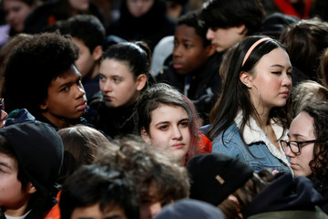 Students from Fiorello H. Laguardia High School sit in silence on West 62nd street in support of the National School Walkout in the Manhattan borough of New York City