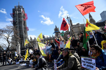 Demonstrators protest against the attack on Afrin, during a march in Westminster, London