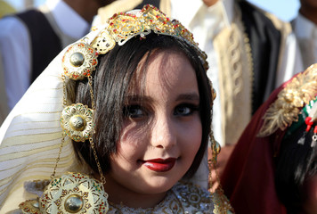 Libyan girl participates in a street festival held to celebrate their traditional clothing, in Tripoli