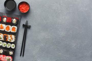Set of sushi maki and rolls on grey background