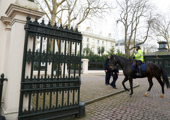 A mounted police officer rides past Russia's Embassy in London
