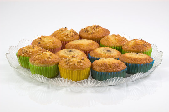 Homemade muffin cake tray, cupcake,banana cake with dried nuts Isolated on white background.