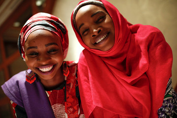 Hauwa and Ya kaka, former captives of Boko Haram militants in Nigeria, pose for a portrait after they appeared on a panel dealing with issues of violence against women in New York