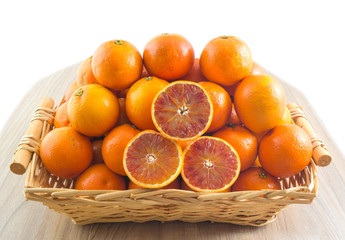 Fresh orange, organic ripe mandarins, pile of orange, sliced orange in wood basket on wooden table background with clipping path.