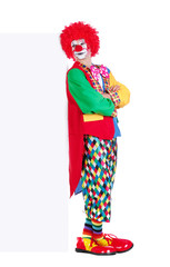 Full length picture of a clown leaning to the vertical blank board