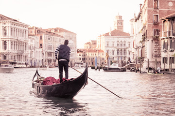 Foto op Plexiglas Gondolas Man on gondola in Venice , Italian street on water, Venetian taxi on water, Symbol of Italian Venice, Beautiful nooks in Venice, Italian street on water, Man on gondola in Venice