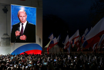 Russian president Vladimir Putin addresses the audience during a rally marking the fourth anniversary of Russia's annexation of Ukraine's Crimea region in the Black Sea port of Sevastopol