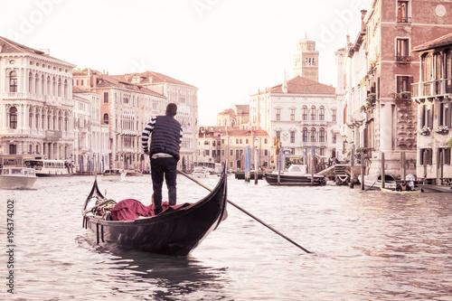 man on gondola in venice italian street on water venetian taxi on