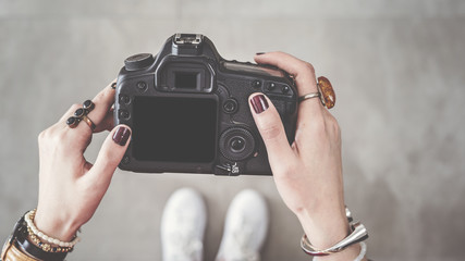 Woman holding digital camera high angle view