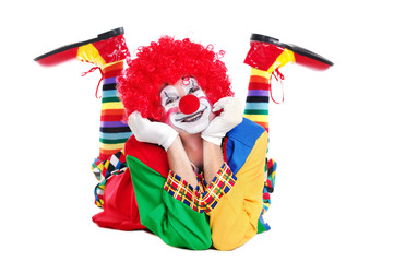 Happy clown  laying on the floor