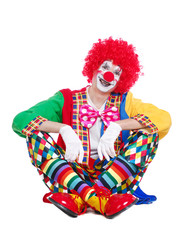 Isolated on white background sitting clown with crossed legs