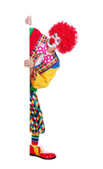 Clown looking to the vertical blank board against white background Full length