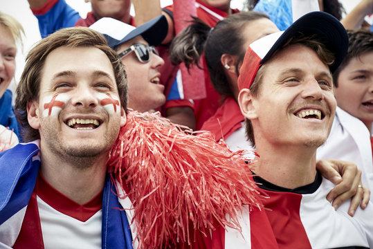 Football fans watching football match