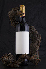 Isolated Red Wine Bottle in a Black Background