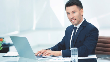 businessman talking on the Internet in the workplace
