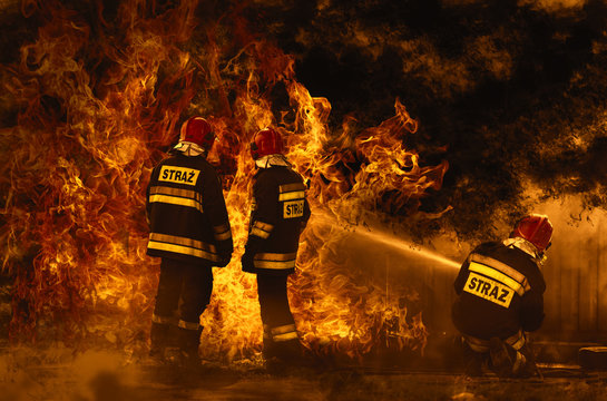firefighters extinguishing a dangerous fire