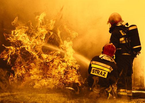 firefighters extinguishing a dangerous fire
