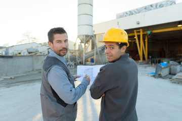 two engineers looking at camera at plant site