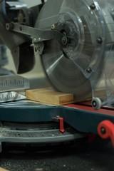 Grinder cutting machine cutting a piece of wood