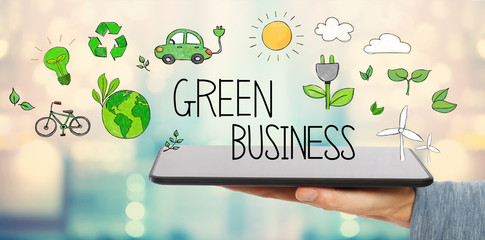 Green Business with man holding a tablet computer
