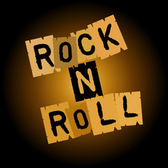 Rock and roll inscription on paper, on a brownish black background