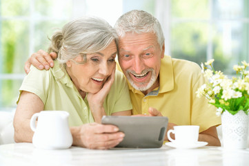 beautiful senior couple using tablet