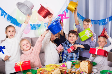 Children exchanging presents at party