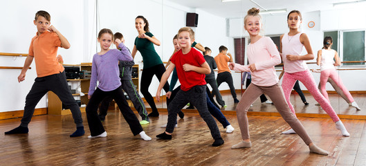 Children studying modern style dance