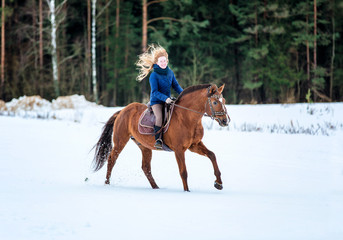 Happy young lady riding a horse.