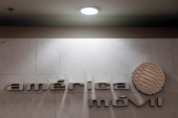The logo of America Movill is seen on a wall at the company's corporate offices in Mexico City
