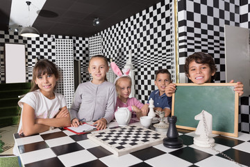 Portrait of children playing in the chess quest room