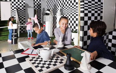 children play in escape room in chess style