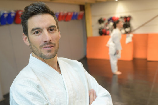 portrait of martial arts student listening attentively to his teacher