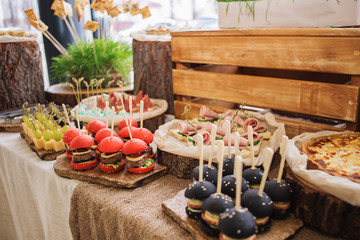 Reception treats on the table for guests from the chief. Food for party. Catering, Closeup.