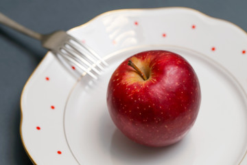 Close up image of red apple on the plate