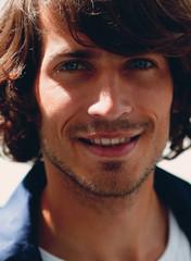 portrait. stylish guy in a plaid shirt. close-up.
