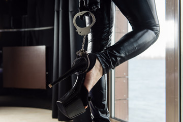 Sexy female feets with high heels and handcuffs