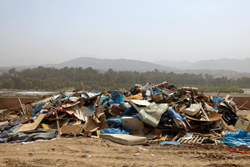 Debris of huts are seen after police evict squatters from a land in Villa El Salvador, on the outskirts of Lima