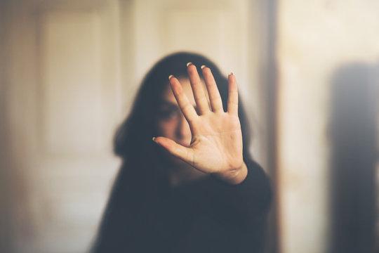 sad woman hand stop or no sign