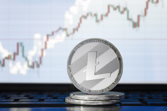 LITECOIN (LTC) cryptocurrency; physical concept litecoin on the background of the chart