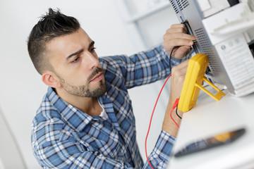 technician measuring devices